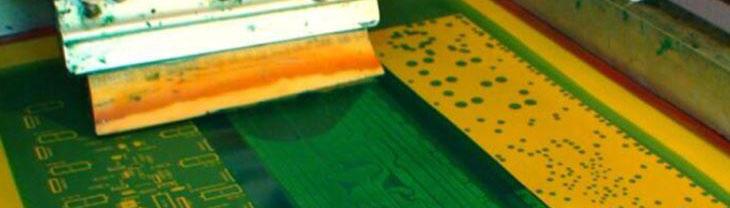 Circuit board being screen printed