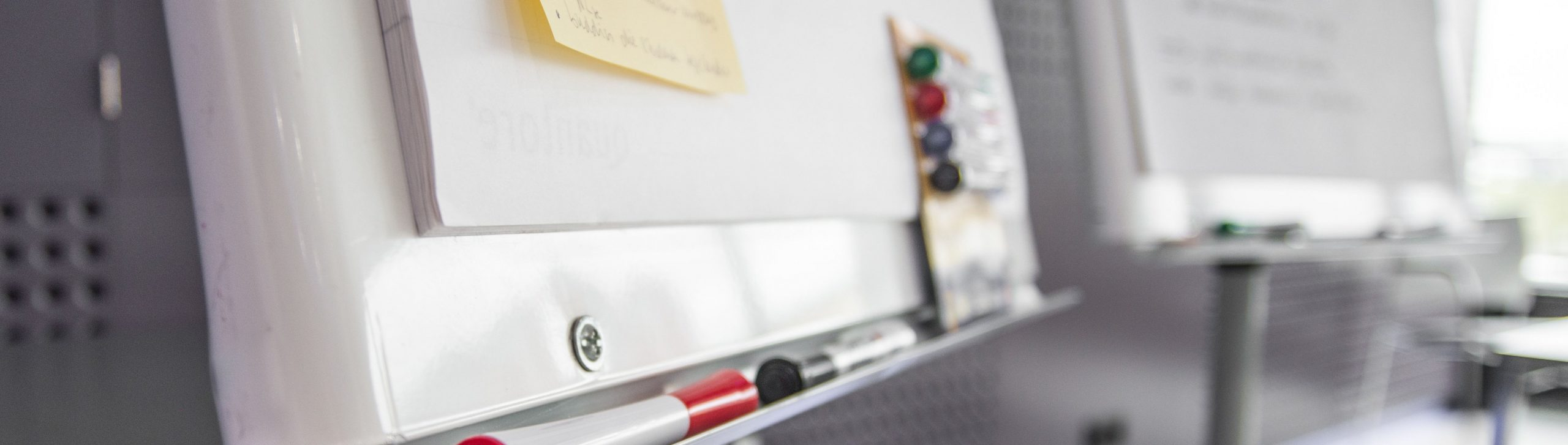 Close up of whiteboard and pens for training