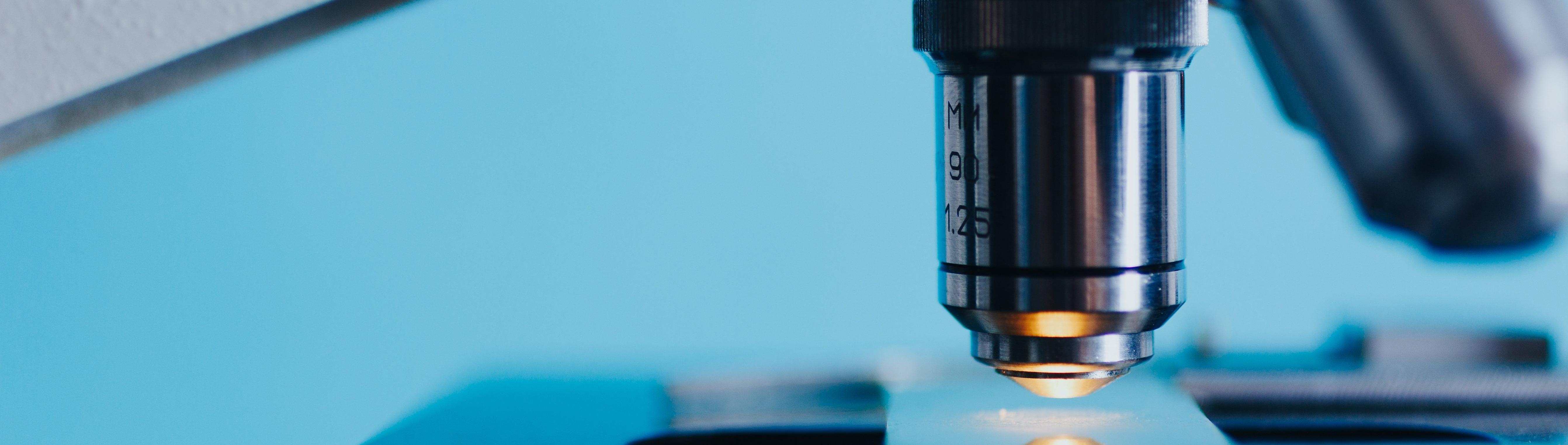 Microscope objective lens over slide
